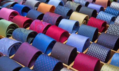 57587682 - colorful tie collection in the men's shop